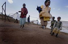 Kenya Children Playing. Could be cool to mix with cell phone, water filtration.