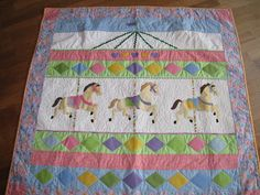 http://sewitsfinished.blogspot.ca/2012/03/carousel-quilt-finished.html
