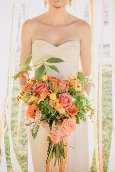 #coral #yellow and citrus hued #bouquet | Photography by www.annadelores.com, Florals by http://www.kissingbees.com  Read more - http://www.stylemepretty.com/2013/09/12/citrus-inspired-photo-shoot-from-anna-delores-photography/
