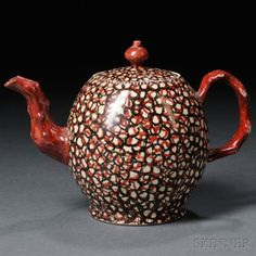 Staffordshire Cream-colored Earthenware Teapot and Cover, England, c. 1790, molded crabstock handle and spout, globular shape allover decorated in a red and black enamel cell design, ht. 5 1/8 in.