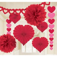 Instantly fill your room with loving spirit with these fab Valentine's Day decorations! Featuring heart banners, garlands, red fluffies, and more, the Valentines Decorating Kit is sure to add an air of a love affair to your Valentine's party! The decorating kit includes 1 - 12 inch red heart garland, 2 - 16 inch red fluffies, 2 - 3 foot pink and red heart hanging garlands, and 4 - 12 inch red heart-shaped fans.