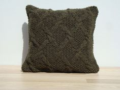 Handmade knitted pillow in dark green color. Cover is two sided. Envelope enclosure with snap fastener on the bottom.  Size: 19x19 / 48cm x 48cm