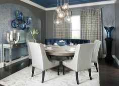 Formal contemporary dinning room with white and blue color combination. #KBHome