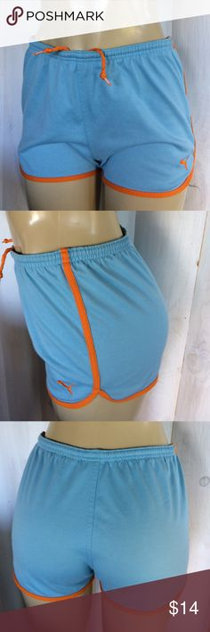 Puma vintage-style super short athletic shorts Puma short athletic shorts. 70's throwback style, Light blue with orange contrasting trim . women's size medium cotton and polyester blend- awesome condition! Puma Shorts