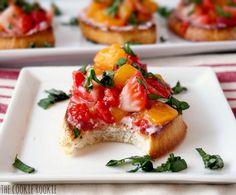 Summer Fruit Bruschetta with Strawberries, Peaches, Basil, Raspberry White Balsamic, and Goat Cheese.  YUM!