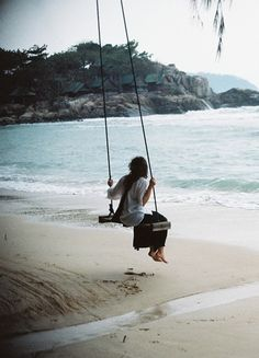 A swing on the beach, looking out at the ocean? Oh baby...let's go now.
