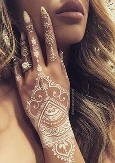 White henna tattoo on ring finger