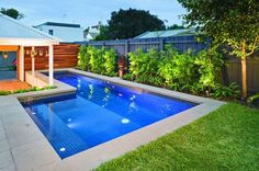 Pool + landscape ~ darker blue mosaic, really love this shape pool and especially love how the gazebo is incorporated.