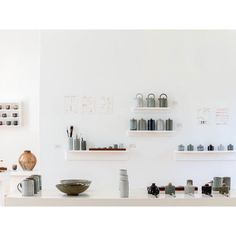 """A photograph of my graduation display in the National Craft Gallery in Kilkenny, Ireland. A collection of mostly functional pots, including teapots,…"""