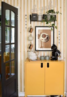 after shot diy coffee station with yellow cabinet stoneware cups on hooks neutral coffee cup wall art on wood panelling and basket shelf Yellow Cupboards, Diy Projects On A Budget, Basket Shelves, Small Space Living, Home Decor Inspiration, Home Organization, Interior Styling, Diy Design, Diy Home Decor