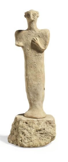 A SYRO-HITTITE TERRACOTTA FIGURE  CIRCA 1500 B.C.  Standing on flaring feet, her left arm bent, the hand on her chest, her face with circular eyes and a prominent nose; together with a Greek pottery figural askos in the form of a bird, circa 3rd century B.C.; a late Roman glass jar, circa 4th century A.D.; and a Roman pottery oil lamp, circa 2nd century A.D., red-slipped, the discus molded with a cornucopia, a workshop stamp on the underside 6¼ in. (13.3 cm.) high