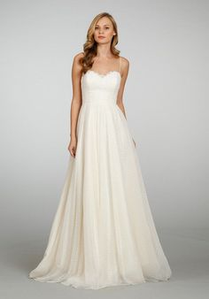 Ivory natural waist A-line swiss dot net bridal gown with spaghetti straps and lace detailing at bust, plunging back and chapel train