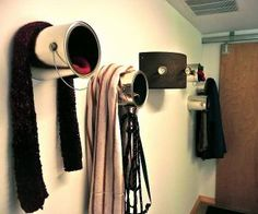 paint can containers... Gloves inside scarves and coats on top?   I like it.  winter wear hallway storage