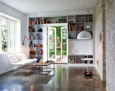 Cement floor, brick wall and built-in bookcase