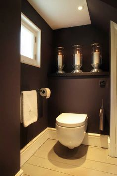Bathroom , Modern Wall Hung Toilet : Wall Hung Toilet With Dark Brown Walls And Towel Bar And Tissue Holder And Candelabra Small Toilet Room, Guest Toilet, Wall Mounted Toilet, Downstairs Cloakroom, Downstairs Toilet, Bathroom Toilets, Laundry In Bathroom, Bathroom Small, Bathroom Modern