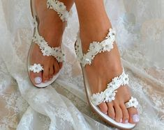Handmade Wedding Sandals by LovelyBrideByAnna on Etsy Discover our collection of Exquisite Handmade Wedding Sandals & Bridal Heels! #weddingsandals #weddingshoes #weddingpearls #handmadesandals #bridalsandals #bridalshoes #greeksandals #pearlsandals #weddingflats #lacesandals #weddinglace #flowersandals #whiteweddingshoes #flatweddingshoes #weddingflats #bridalflats #romanticsandals #weddingsandalslace