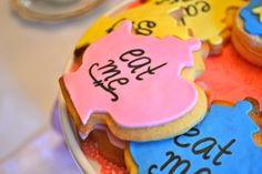 Alice in wonderland birthday party in blue yellow and pink tea pot cookies say eat me