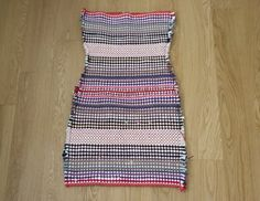 I saw these multicoloured rugs down at my local dollar store, which are made out of recycled jersey t-shirts. They have a great amount of stretch to them so I bought a few for fun. I fell in love with the multi-coloured, ever so slightly tribal look. After making the skirt you may have seen a...