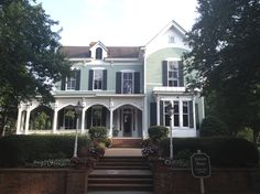 The Jackson House that sits near the entrance of Reynolds Plantation. Dismantled and moved from its original downtown location, it was restored and is a good example of examples of Steamboat Gothic architecture.