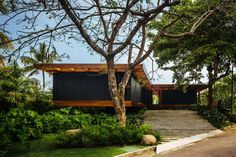 Jacobsen Arquitetura design the RT House located in a private area surrounded by vegetation - CAANdesign | Architecture and home design blog