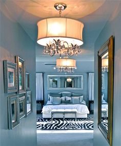 Love all the shades of blue in this bedroom - the pops of white and black are the perfect accents.