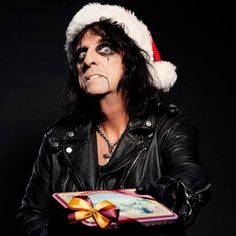 Alice Cooper, captured here by Mathieu Zazzo, takes on the role of NME's Bad Santa for the 2011 Christmas issue.