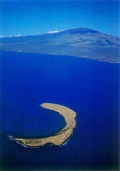 Aeriel view of Molokini crater with Haleakala in the background. Maui, Hawaii. #molokini #maui #hawaii