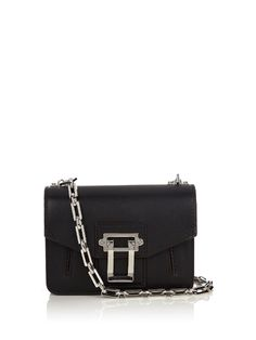 Just like the label's ready-to-wear, Proenza Schouler's Hava bag showcases a modern but artisanal attention to detail. It's crafted in Italy from timeless black leather, and outlined with rich burgundy lacquered edges.