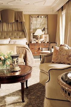 Sitting area is perfect for quiet get-away in this master bedroom..... Gorgeous creams and grays