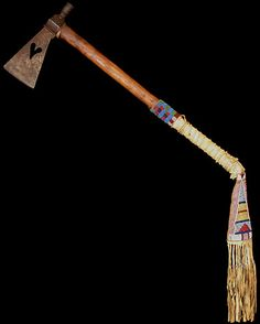 """Crow Tomahawk with Drop, ca. 1870 Pipe tomahawk with heart cutout on blade, beaded and wrapped handle with beaded and fringed drop. As mounted: 31"""" long"""