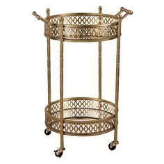 <p>A stunning addition to any ensemble, this lovely cart offers up both serving and style possibilities.</p><p>Finished in gleaming gold leaf, its metal frame features 4 rimmed legs and a circular silhouette. Each of its 2 tiers are mirrored, then wrapped in a chic openwork trellis band. A castered base and 2 top handles let your effortlessly roll it around your home.</p><p>Fill its shelves with crystal stemware and liquor-filled decanters to craft a mi...