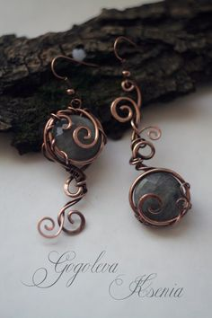 Wire creative earrings with spiral wire wrapping and gemstone beads