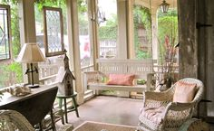 Charming screen porch. Love the aged cyprus wood and vintage hanging led glass panels.