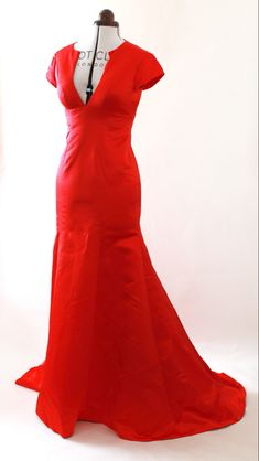 An elegant red evening dress featuring cap sleeves, a flattering mermaid skirt, deep V-neckline and a floor- sweeping chapel train that ups the drama. Affordable Evening Dresses, Evening Dresses Uk, Gala Dresses, Mermaid Evening Dresses, Red Carpet Dresses, Formal Dresses, Mermaid Skirt, Chapel Train, Polyester Satin