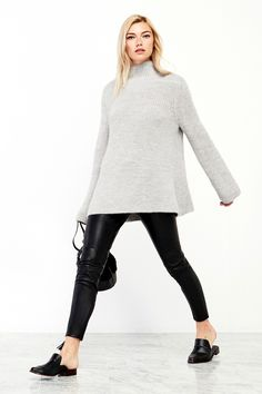 Photos via: Reformation I love a good turtleneck, especially when they are this oversized and...