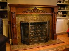 The fireplace was white particle board. Granite was used for the countertops in the kitchen and we had some left over. After buying a few carvings and posts, we assembled it for this major improvement.