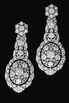 Pair of diamond pendent ear clips, 1930s Each of foliate design, pierced and millegrain-set with circular-, single-cut and rose diamonds, later clip fittings.