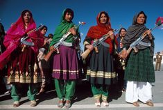Afghanistan, Kabul. May 27, 1986. Armed women in traditional clothes celebrate the anniversary of the Coup d'Etat of 1978,  A. Abbas.