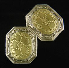 Elegant engraved cufflinks with bold geometric borders surrounding yellow gold centers with richly engraved swag and floral designs.  Crafted in 14kt white and yellow gold,  circa 1920.