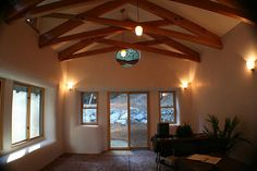 nice high ceiling on straw bale house interior, love it