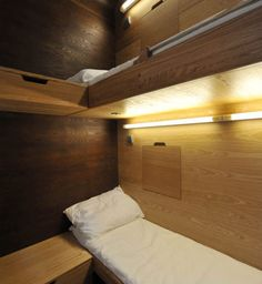 Sleepbox mini hotels, designed by Arch Group (Russia) – Nine-feet high pods with (up to) three beds, bedside tables, electrical outlets and reading lamps at $15/hour with optional add-ons of WiFi, televisions and an alarm clock. The first pods are running in Moscow's Sheremetyevo airport.