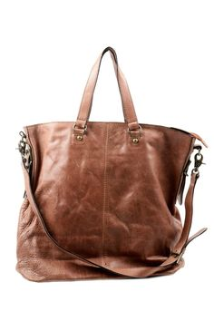 Cute brown leather bag seems like it just might accommodate my life and all the stuff it takes to get me through the day!  Love!