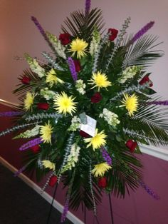 Live Funeral Spray using Yellow Fuji mums, purple liatris, white snapdragons, red roses and eucalyptus as filler.  October 2015