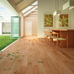 Lighter-toned hardwood floors are a great way to keep an open space light and airy.