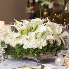 The holidays are the time to really kick your table centerpieces up a notch. When you're serving elegant holiday dinners, it just feels appropriate to have an equally elegant floral arrangement to go along with it. Paula loves making large-scale arrangements, from a grand Lowcountry centerpiece to a low winter-white arrangement. The best part about