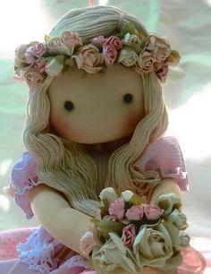 By Javiera Moris Ferrando.....(omGEE...this doll is soooo BEAUTIFUL! i love her flower haku, too!)....