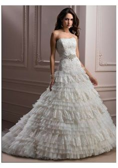 Tull Strapless Softly Curved Neckline Lace Bodice Beaded Waistband with Bow Back A-Line Tiered Skirt with Lace Trim and Chapel Train 2012 New Arrival Wedding Dress