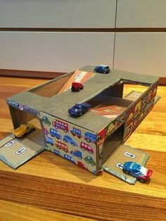 Reuse and up-cycle your cardboard boxes and create fun toys for next to nothing. Check out this DIY cardboard car garage.