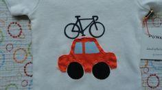 Toy car with bike on rack onesie in orange