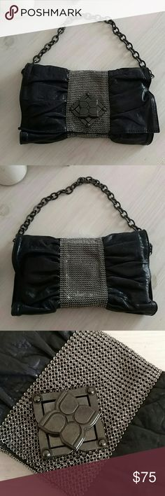 BCBG black mesh bag BCBG black leather clutch with dark silver mesh. Interior is very clean. Removable chain  so can be use as a clutch. Dust bag is included BCBG Bags